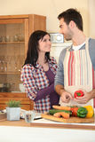 Couple smiling in the kitchen Royalty Free Stock Image