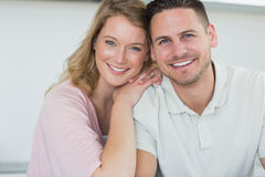 Couple smiling in kitchen Stock Photography