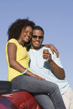 Couple Smiling And Listening Music Stock Photography