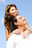 Couple smiling and looking away Royalty Free Stock Photography