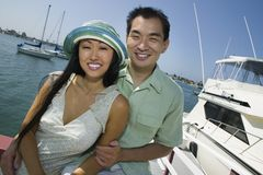 Couple smiling at marina (portrait) Stock Photography