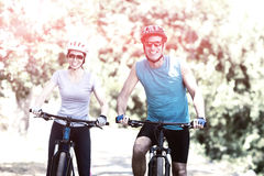 Couple smiling and posing with their bikes royalty free stock photography