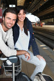 Couple smiling at railway station Royalty Free Stock Image