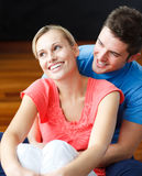 Couple smiling in their new house Royalty Free Stock Photos