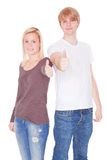 Couple smiling thumbs up Stock Photography