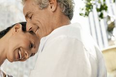 Couple Smiling Together. Close up of couple smiling together stock photo