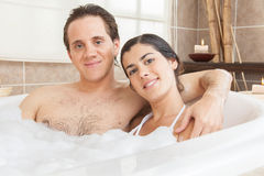 Couple smiling in the tub Stock Photo
