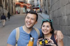 Couple smiling while visiting Europe.  stock image