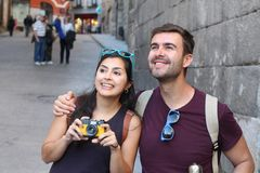 Couple smiling while visiting Europe.  stock photography