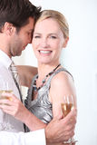 Couple smooching. With glass of champagne Royalty Free Stock Photography