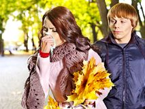 Couple sneezing  autumn outdoor. Stock Photography