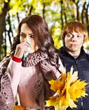 Couple sneezing  autumn outdoor. Royalty Free Stock Photography