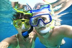 Couple snorkeler in ocean. Woman and men doing snorkeling in the blue sea Stock Photo