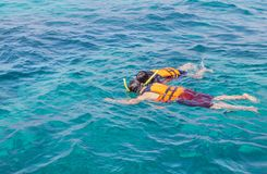 Couple snorkeling with life jackets in andaman sea stock image