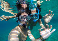 Couple snorkeling in Maldives. Young Couple snorkeling in Maldives island Royalty Free Stock Image