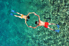 Couple snorkeling in Phi Phi island, Thailand Royalty Free Stock Photography