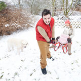Couple in snow with christmas gifts and sled Stock Photography