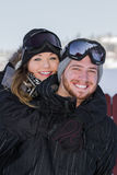 Couple in snow gear Royalty Free Stock Photo