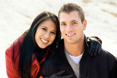 Couple in the snow. Portrait of a mixed race middle aged couple in the snow Stock Images