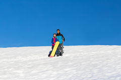 Couple With Snowboard And Ski Resort Snow Winter Mountain Cheerful Hispanic Man Woman Royalty Free Stock Photography