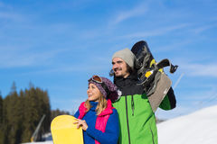 Couple With Snowboard And Ski Resort Snow Winter Mountain Smiling Man Woman Royalty Free Stock Images