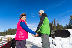 Couple With Snowboard And Ski Resort Snow Winter Mountain Smiling Man Woman Royalty Free Stock Photo
