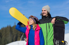 Couple With Snowboard Ski Resort Snow Winter Mountain Smiling Man And Woman Extreme Sport Vacation Stock Images