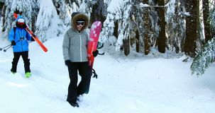 Couple with snowboard walking snow 4k. Couple with snowboard walking snow during winter 4k stock video footage