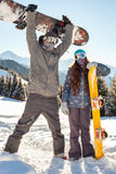 Couple snowboarder in place in the mountains Stock Image