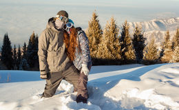 Couple snowboarder in place in the mountains Stock Images