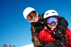Couple of snowboarders. Portrait of happy couple of snowboarders outside during winter vacations Stock Photos
