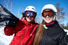 Couple of snowboarders. Portrait of happy couple of snowboarders outside during winter vacations Royalty Free Stock Photos
