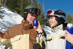 Couple of snowboarders Stock Photo