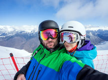 Couple snowboarders doing selfie on camera Stock Photos