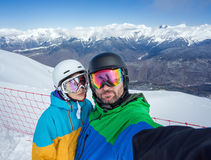 Couple snowboarders doing selfie on camera Royalty Free Stock Image