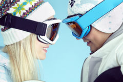 Couple snowboarders. Young men and women wearing ski goggles looking at each other Royalty Free Stock Photography