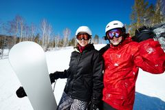 Couple with snowboards. Portrait of happy couple of snowboarders outside during winter vacations Stock Images
