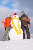 Couple with snowman Stock Photo