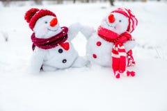 Couple of snowmen Stock Photos