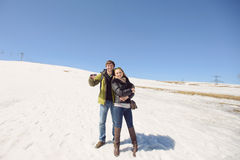 Couple on Snowy Hill Stock Photos