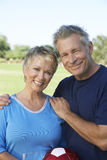 Couple With Soccer Ball In Park Stock Photography