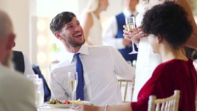 Couple Socialising At Their Wedding. Bride and groom socialising with their guests at their wedding reception stock video