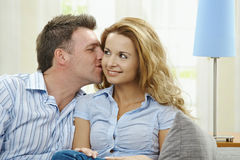 Couple on sofa Royalty Free Stock Photos