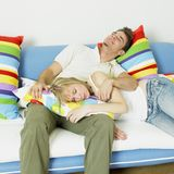 Couple on sofa Royalty Free Stock Photography