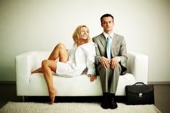Couple on sofa Royalty Free Stock Image