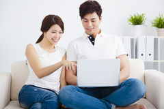 Couple on sofa with laptop computer Royalty Free Stock Photo