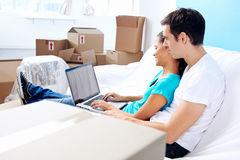 Couple on sofa moving Stock Photos
