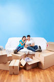 Couple on sofa moving royalty free stock image