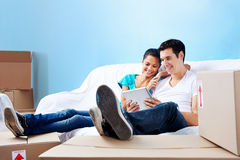 Couple on sofa moving Royalty Free Stock Photography