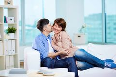 Couple on sofa Stock Photography